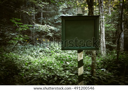 plate and pillar in the forest, national park, protected areas, state property