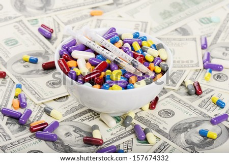 Plate full of tablets, pills and syringes (installation on the theme of modern medicine trends) - stock photo
