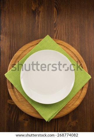 plate, knife and fork  on wooden background - stock photo