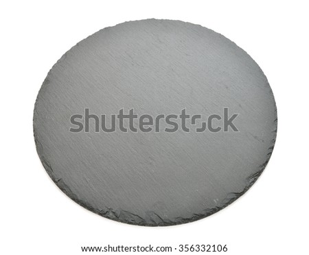 Plate made of natural black slate isolated on a white background - stock photo