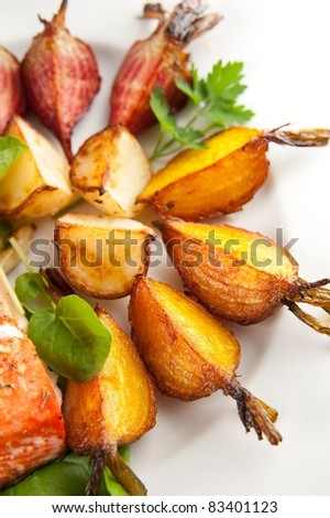 Plate of Assorted Root Vegetables Grilled in Butter with Sea Salt and Herbs - stock photo