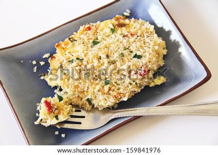 plate of baked spaghetti squash - stock photo