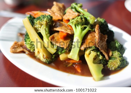 Plate of broccoli with vegan seitan as a meat substitute. - stock photo