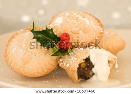Plate of Christmas mince pies with cream - stock photo