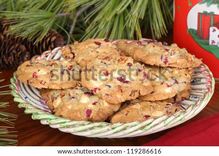 Plate of cranberry and nut Christmas cookies - stock photo