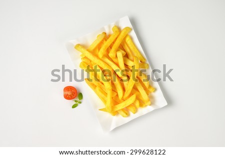 plate of french fries on white background - stock photo