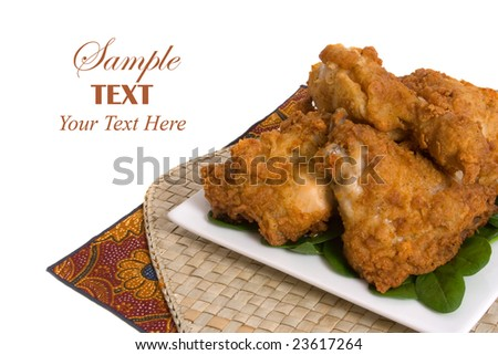 Plate of Fried Chicken over white background with copy space for text - stock photo