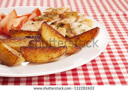plate of fried potatoes on red and white checked cloth