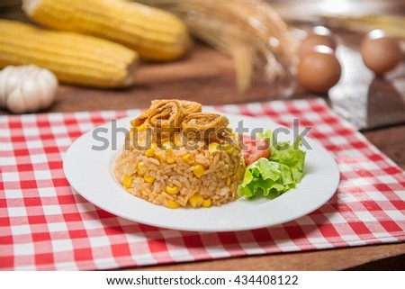 Plate of fried rice with herbs on the table in restaurant - stock photo