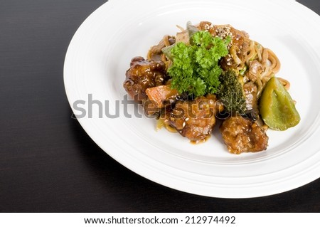 Plate of General Tso's chicken - stock photo