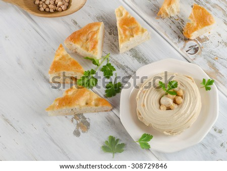 Plate of  Healthy Homemade Creamy Hummus with pita. Top view - stock photo