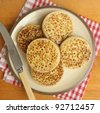 Plate of hot buttered crumpets - stock photo