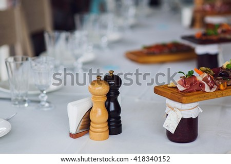 Plate of Italian Appetizer briquettes on wooden desk on the table.Italian antipasti, jamon, prosciutto, chorizo, salami on a grunge black board, rustic style. Selective focus. - stock photo