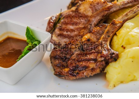 Plate of lamb chops with mashed potatoes. - stock photo