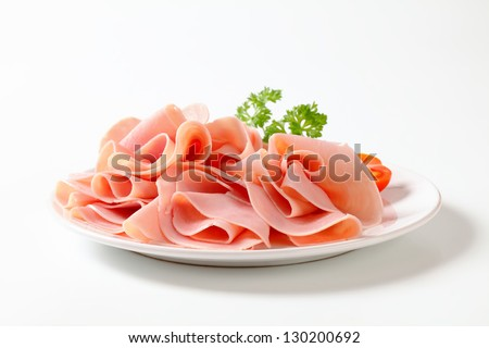 plate of lean ham with parsley - stock photo