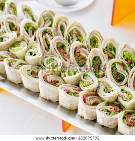 Plate of many mini bite size sandwich appetizers - stock photo