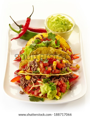Plate of Mexican food Tacos isolated on a white background - stock photo