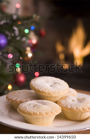 Plate of Mince Pies, Log Fire and Christmas Tree - stock photo