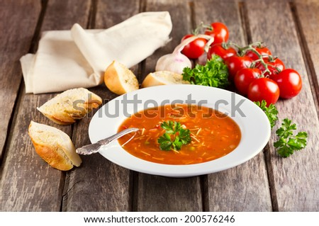 plate of Minestrone Soup on wooden background - stock photo
