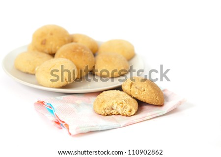 Plate of moroccan butter biscuits on white background - stock photo