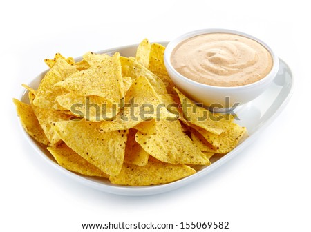 Plate of nachos and dip - stock photo