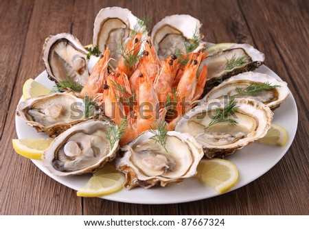 plate of oyster and shrimp - stock photo