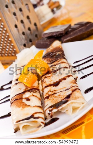 plate of pancakes decorated with orange peel