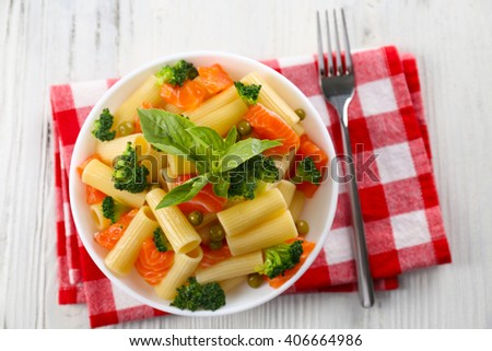 Plate Of Pasta With Salmon And Broccoli On Wooden Table Top View