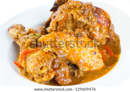 plate of roasted chicken cooked in barbecue sauce