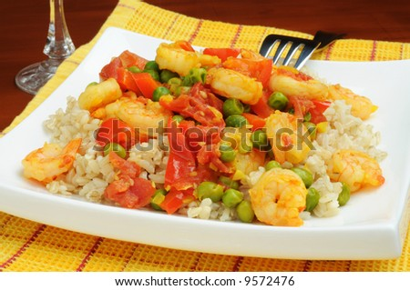 Plate of saffron shrimp served with rice.