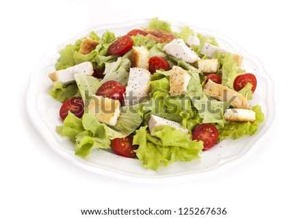 plate of salad with chicken breast and croutons isolated on white background - stock photo
