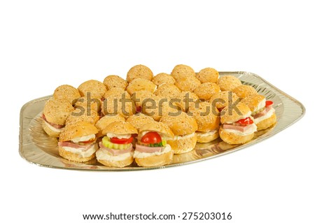 Plate of sandwiches isolated on a white background.