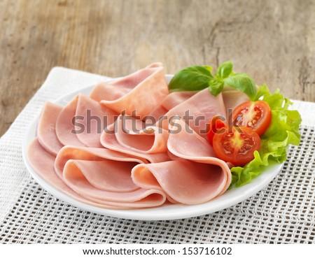 plate of sliced pork ham - stock photo