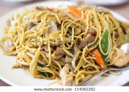 Plate of stir-fried chow mein at a Chinese restaurant.