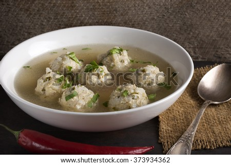 Plate of the soup with chicken meatballs
