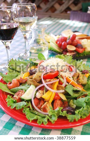Plate of tortellini and vegetable salad at restaurant - stock photo