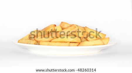 Plate of UK English chips or fries with slight shadow on backdrop - stock photo