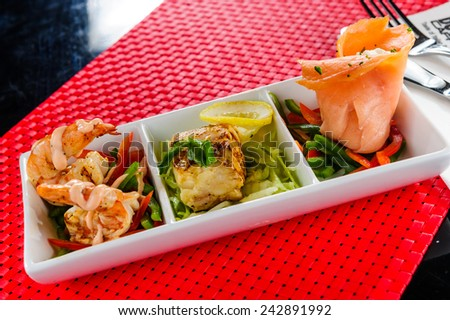 Plate of various smocked fish. - stock photo