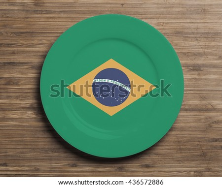 Plate on table with overlay flag of Brazil - stock photo