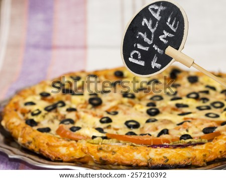 "Plate ""Pizza time"" on background of tasty italian pie - stock photo"