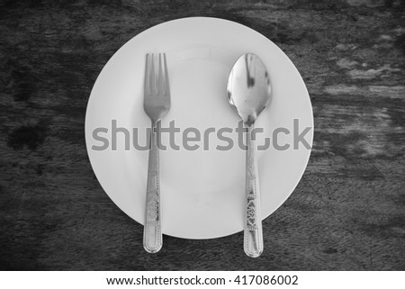 Plate, Spoon and Fork - stock photo
