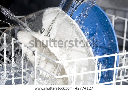 Plate waning in dishwasher - stock photo