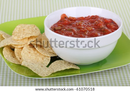 Plate with a bowl of salsa and tortilla chips