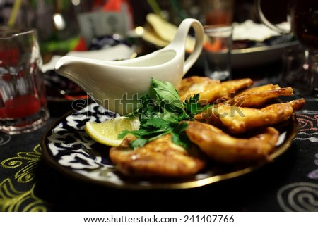 Plate with battered cod in the asian restaurant - stock photo