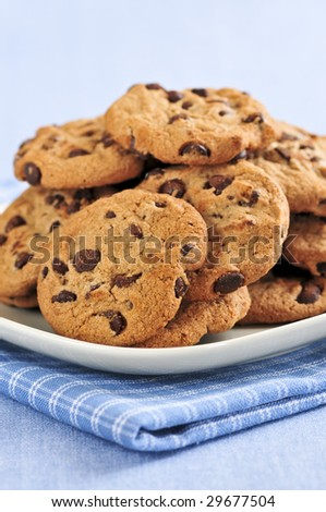Plate with big pile of chocolate chip cookies - stock photo