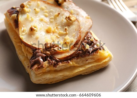Plate with delicious pastry, closeup