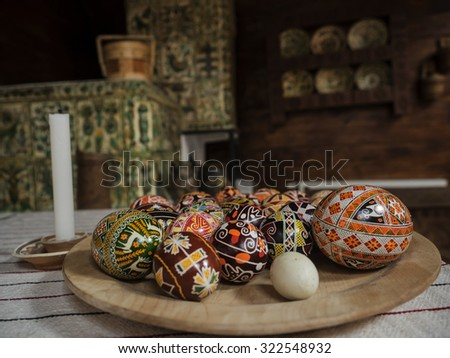 Plate with eastern eggs with the traditional designs in Ukranian house - stock photo