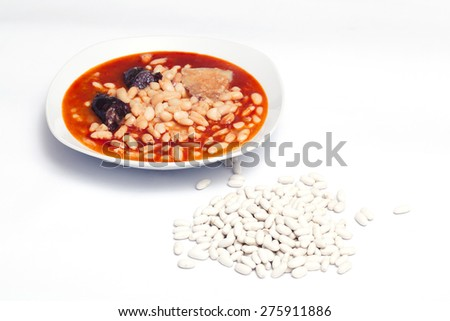 Plate with fabada asturiana, a typical spanish bean stew.