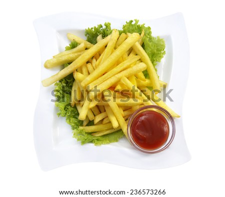 Plate with french fries served with lettuce and ketchup, fried potato chips, isolated on white, snack and fastfood - stock photo