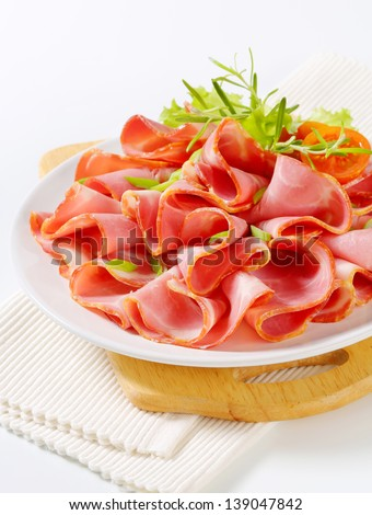 plate with fresh lean ham and spring onion